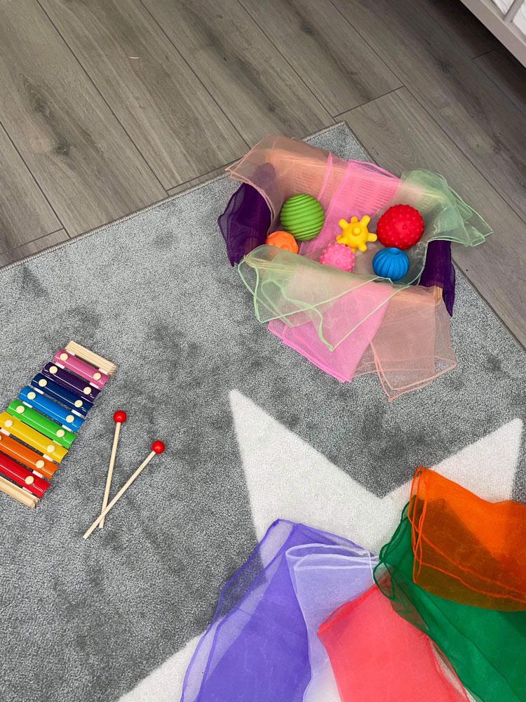Fabrics, xylophone and sensory bin